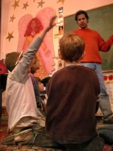Young boy raising hand in math class at Living Wisdom School in Palo Alto, California