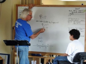 Math team teacher Gary McSweeney helps a student understand a concept at Living Wisdom School in Palo Alto, California