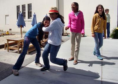 Middle school girls play basketball, Living Wisdom School, Palo Alto, California