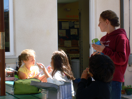 Teacher Erica at recess with her first-graders, Living Wisdom School, Palo Alto, California