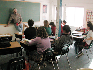 Gary McSweeney teaches math to middle schoolers at Living Wisdom School in Palo Alto, California