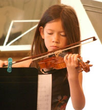 Girl playing violin at Living Wisdom School in Palo Alto, California