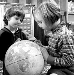 Two young children looking at globe, Living Wisdom School, Palo Alto, California