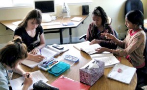 Middle school girls work together at Living Wisdom School in Palo Alto, California