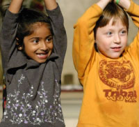 Two children with arms raised at Living Wisdom School in Palo Alto, California