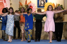 Children dance during school play at Living Wisdom School, Palo Alto, CA