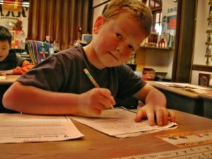 Young boy works at Living Wisdom School in Palo Alto