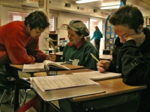 A teacher helps a middle school girl at Living Wisdom School in Palo Alto, CA