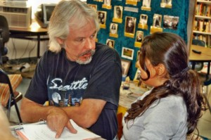 Gary McSweeney, middle-school teacher at LWS, helps a student.