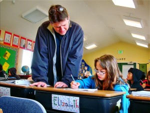 Eric helps Elizabeth in math class at Living Wisdom School in Palo Alto.