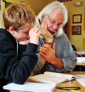 Middle school teacher Gary McSweeney helps a student in math. (Click to enlarge.)