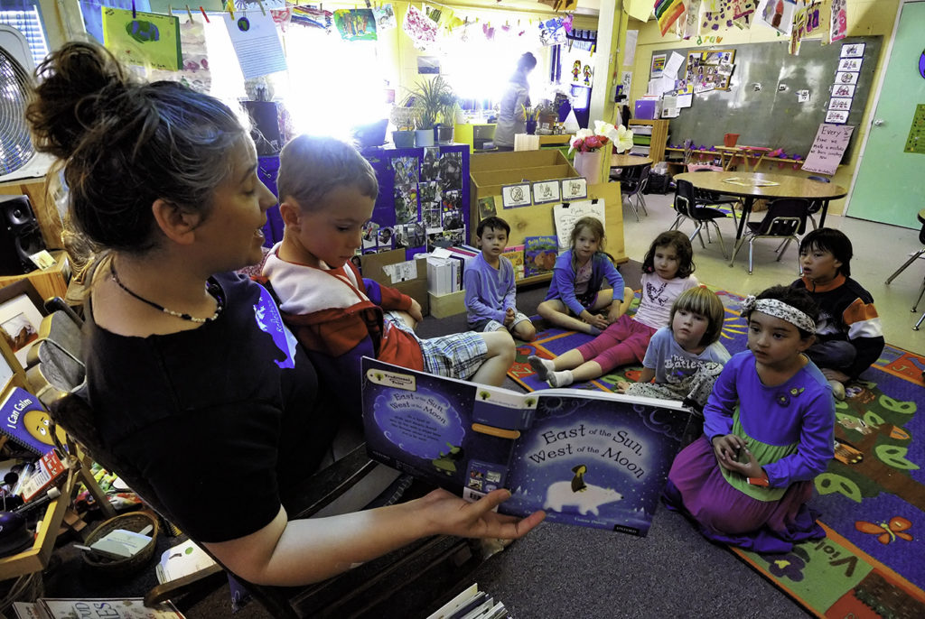 Teacher Mahita Matulich reads to the kindergarten children at Living Wisdom School in Palo Alto