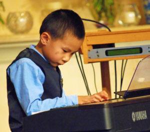 Arthur Gu performs an advanced classical piece during the 2015 LWS Spring Concert
