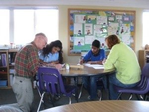 Math teaching aide Richard Fouquet, a retired publisher and tech-industry executive, helps middle-school students.