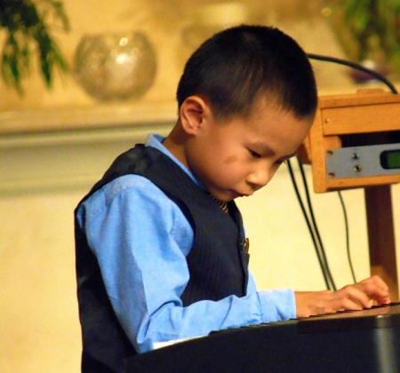 Third-grader Arthur Gu plays a difficult classical piece during the 2016 LWS Spring Concert.